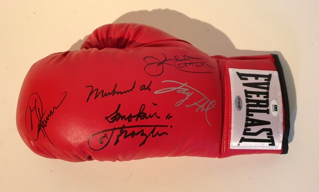 Heavyweight Champions of the World - Glove Signed by Ali, Frazier, Foreman, Holmes and Norton