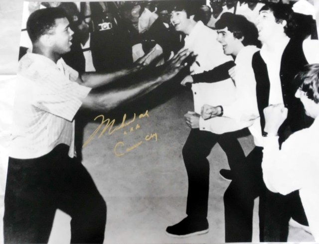 "Muhammad Ali Personally Signed Photo Series - ""Ali Fronts the Beatles"" - Signed ""Muhammad Ali AKA Cassius Clay"""