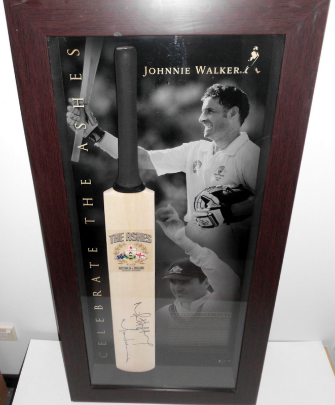 Mike Hussey and Marcus North Personally Signed 2010-2011 Ashes Celebration Bat, Framed